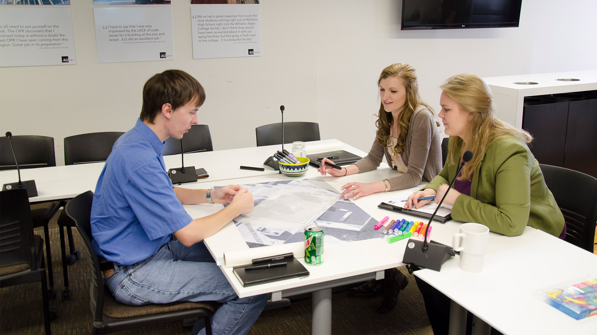 Two interns working with a mentor